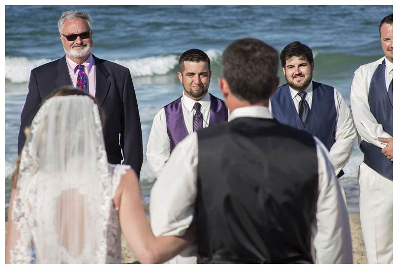groom seeing bride for the first time, grooms reaction, beach wedding