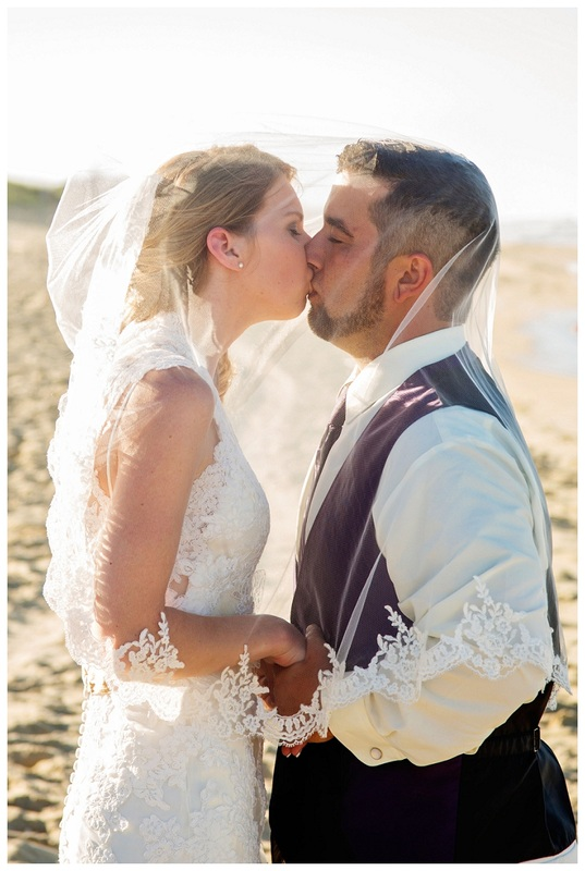 bride and groom kissing under veil, beach portraits, NC