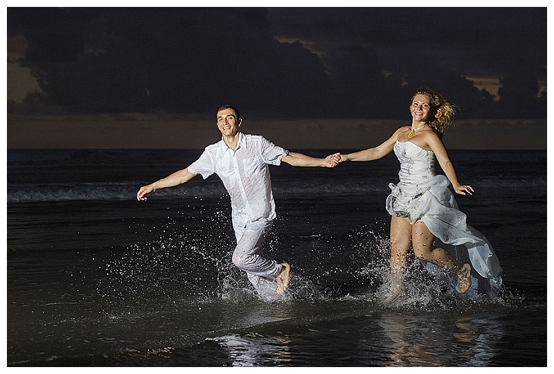 bride and groom running in water, wedding photography, costa rica