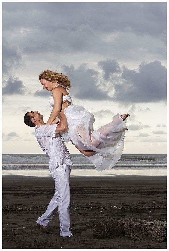 Jumping in the air, bride and groom, trash the dress photos